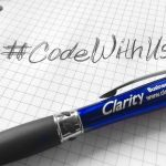 photo of handwritten #codewithus on graph paper with a blue Clarity pen